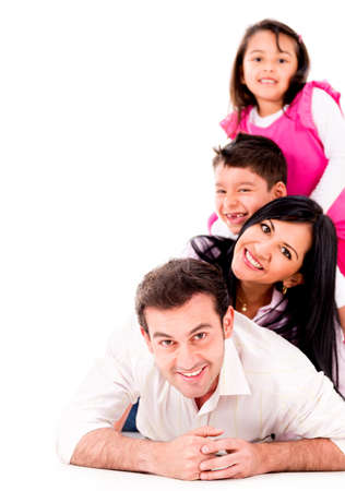 family smiling: Beautiful family smiling together - isolated over a white background