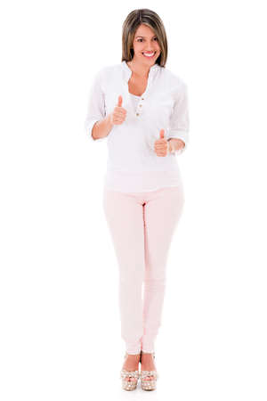 Positive woman with thumbs up - isolated over a white background  photo