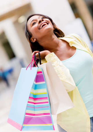 Very happy shopping woman at the mall  Stock Photo - 20615721