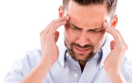 hoofdpijn: Gefrustreerde zakenman met een hoofdpijn - geà ¯ soleerd over white Stockfoto