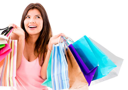 gift bag: Happy shopping woman smiling - isolated over white background