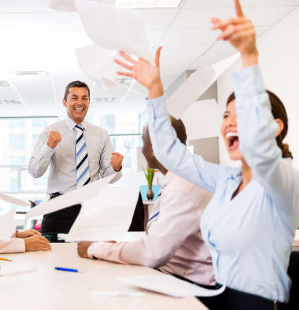 Successful business team celebrating at the office in a meeting  Stock Photo - 20679880