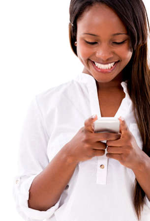 Happy woman texting on her phone - isolated over white background photo
