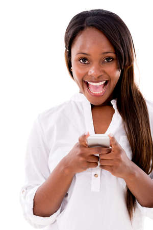 Excited woman texting on her phone - isolated over white background  photo