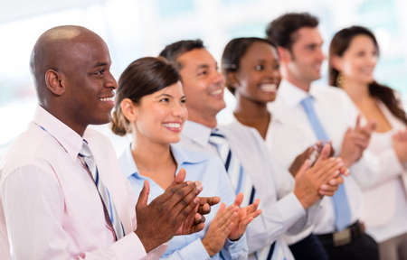 Successful business presentation and a group of people applauding  Stock Photo - 20687447