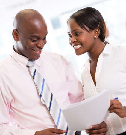 African american business couple working at the office  photo