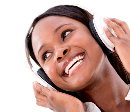 Woman listening to music with headphones - isolated over white background photo