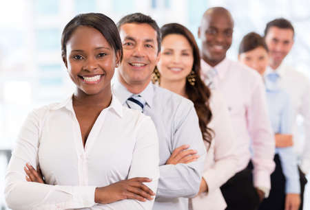 lead: Successful woman leading a business group and looking happy Stock Photo