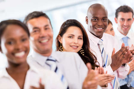 partners: Successful business group applauding after a presentation