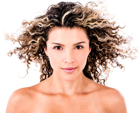 hair curly: Beauty female portrait with curly hair in the wind - isolated over white