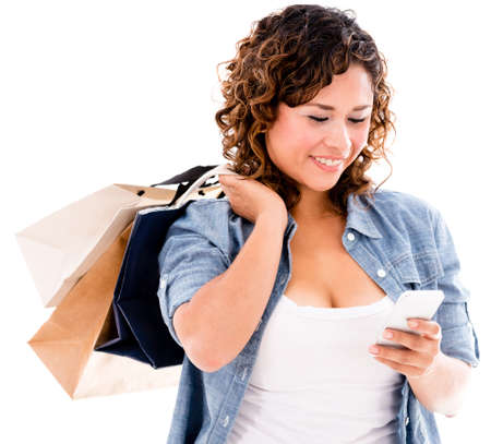 Shopping woman using app on a smart phone  - isolated over white photo