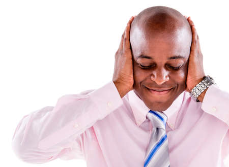 Deaf business man covering his ears - isolated over white background photo