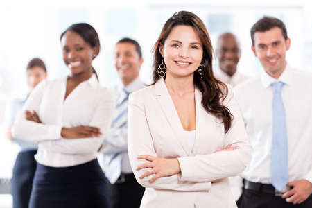 leader lead: Successful business woman leading a group at the office Stock Photo
