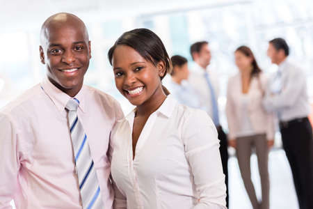 Black business couple looking happy at the office photo