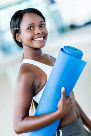 yoga mat: Fit woman at the gym holding yoga mat