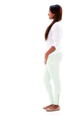 Happy woman walking to the side - isolated over white background Stock Photo - 20679195