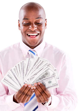 Successful business man holding dollar bills - isolated over white photo