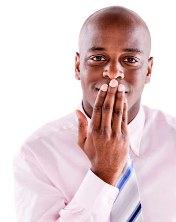 Speechless business man covering mouth - isolated over white background photo