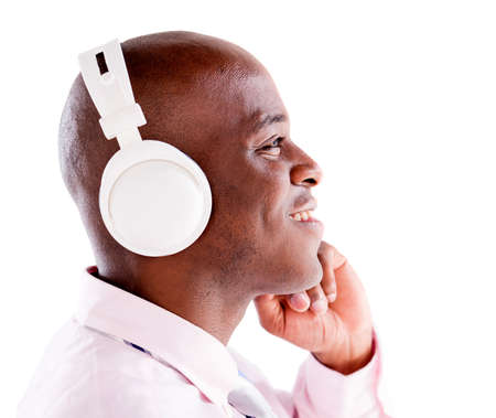 Business man with headphones listening to music - isolated over white background photo