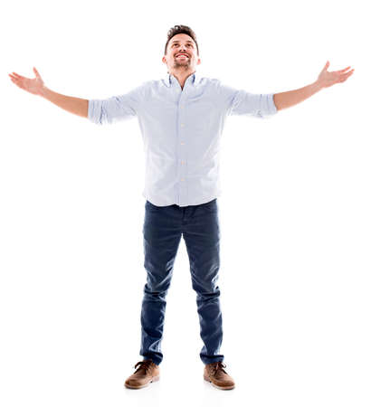 Happy man with arms open - isolated over a white background photo