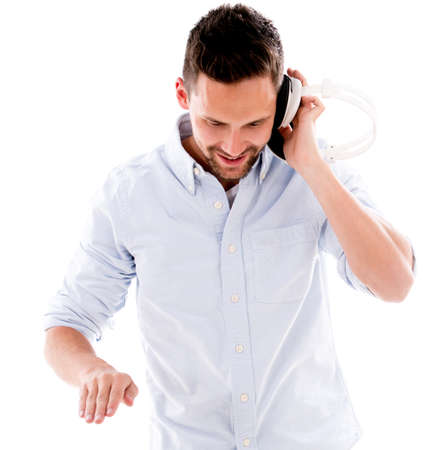 Male DJ with headphones - isolated over a white background Stock Photo - 20687459