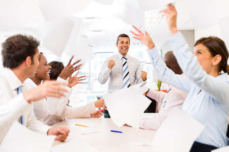 team victory: Successful business group  celebrating at the office Stock Photo