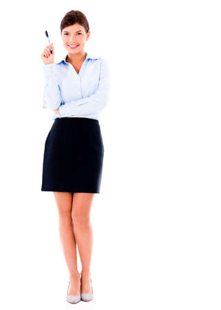 Business woman pointing with a pen - isolated over a white background photo