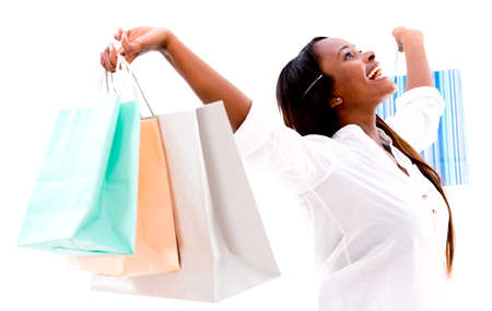 american content: Happy shopping woman with arms up - isolated over white background
