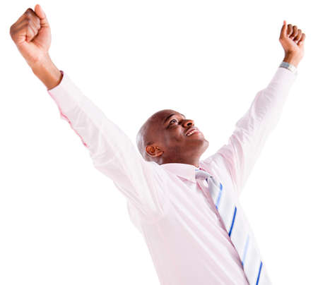 Successful business man with arms up celebrating - isolated over white photo