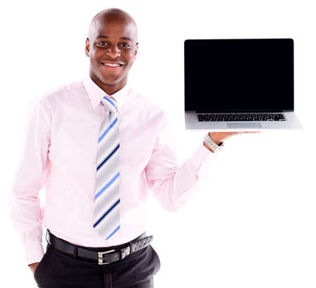 displaying: Business man holding a laptop displaying the screen - isolated over white