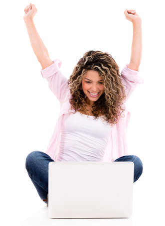 excited: Happy woman with arms up working online - isolated over white background Stock Photo