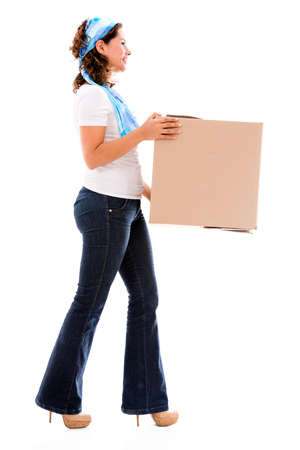 Woman moving house and carrying a box - isolated over white photo
