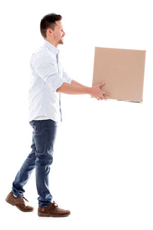 Delivery man carrying a box - isolated over a white background photo