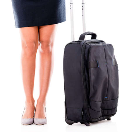 Woman on a business trip carrying a bag - isolated over white Stock Photo - 20786165