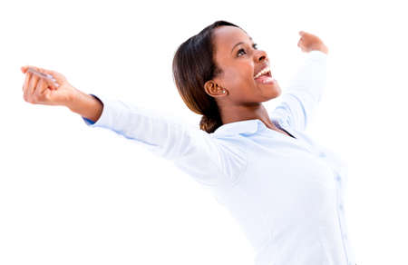 Successful business woman with arms up celebrating a triumph - isolated photo