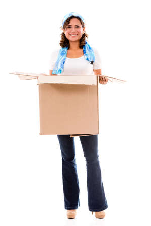 Happy woman moving and carrying a box - isolated over white photo