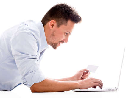 shopper: Man shopping online with a credit card - isolated over white