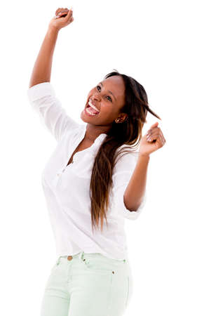 Happy woman with arms up having fun - isolated over white photo