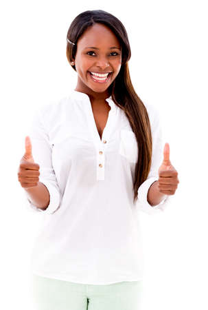 Woman with thumbs up smiling - isolated over a white background Stock Photo - 20832755