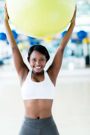 Happy woman doing Pilates with a fitness ball and smiling Stock Photo - 20879534