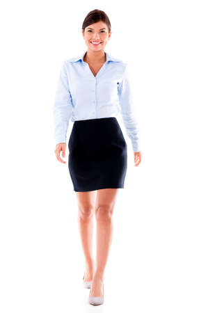 Beautiful business woman walking - isolated over white background Stock Photo - 20893855