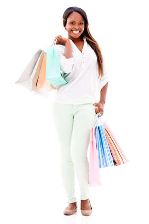 Happy female shopper holding shopping bags - isolated over white background photo