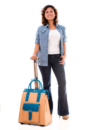 Happy woman going on a trip with her bag - isolated over white Stock Photo - 20893858