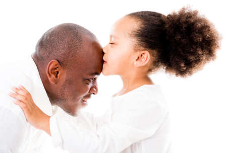 american content: Girl kissing her father in the forehead - isolated over white backgorund Stock Photo