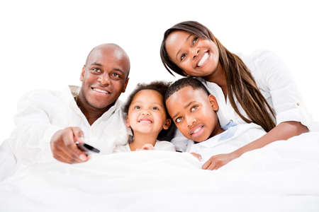Family watching television - isolated over a white background photo