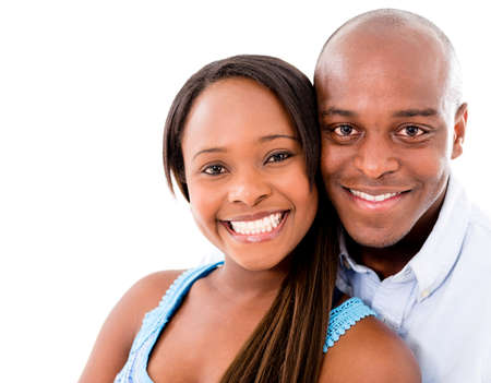 happy african: Beautiful portrait of a happy couple – isolated over white