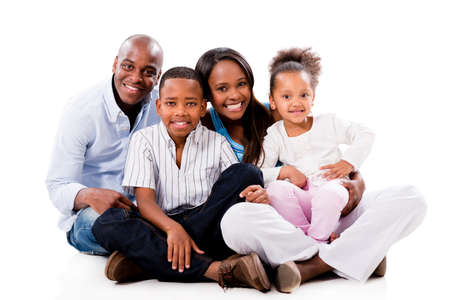 Happy family portrait sitting on the floor - isolated over white photo