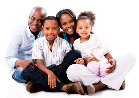 american children: Beautiful African American family looking happy - isolated over white