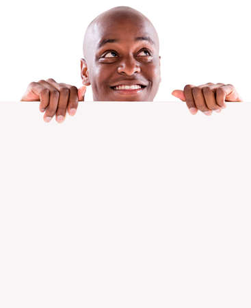 Thoughtful man with a banner - isolated over a white background Stock Photo - 20924532