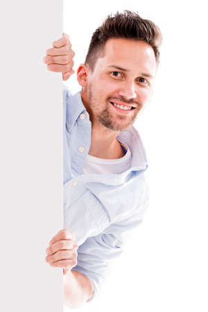 Man holding a banner - isolated over white background Stock Photo - 20924537